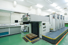 Four-color sheet-fed offset printing press